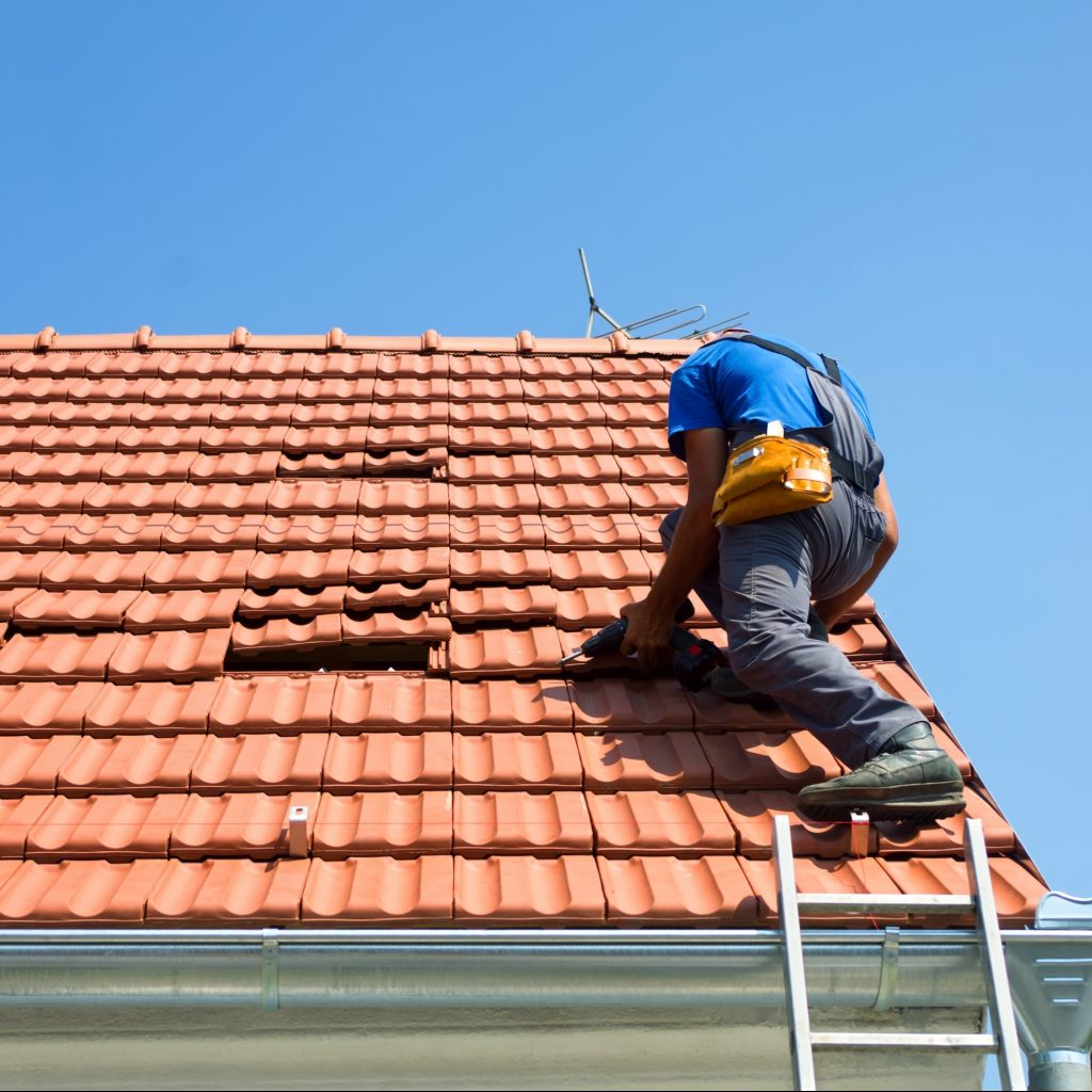 Roofer repairing storm damage.