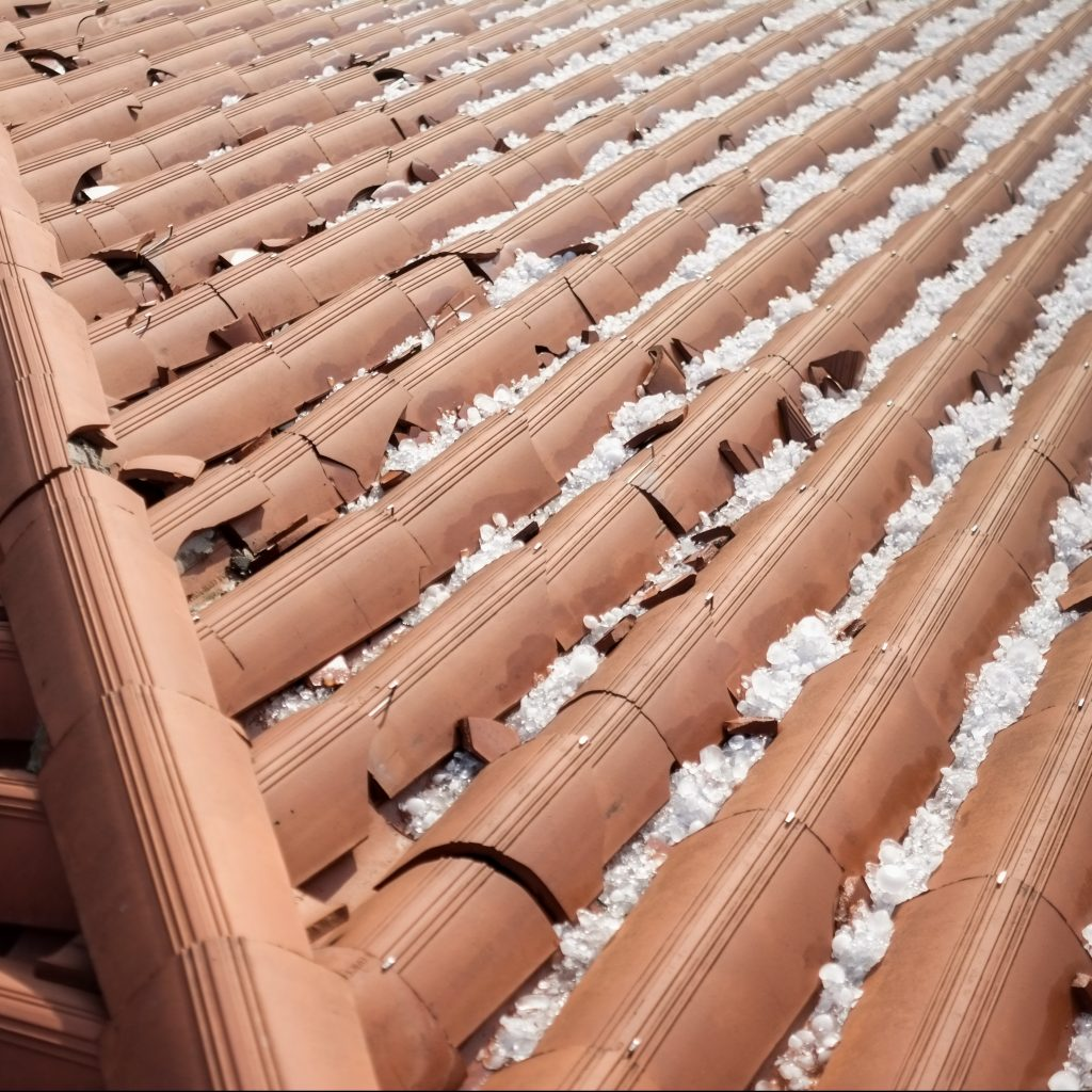 Hail stones and damaged roofing tiles.