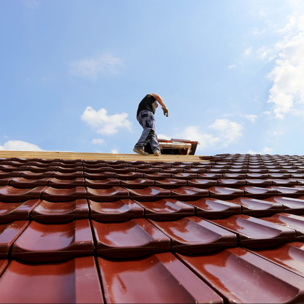 Roofing contractor working on roof.